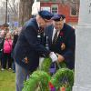 Bill Hale WWII veteran placing a wreath at the cenotaph in Gananoque on 11 Nov 2015 accompanied by Owen Fitzgerald.