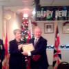 John Peter receiving the Honoree Award on 1 January 2016 from Her Worship Erica Demchuck, Mayor of Gananoque.