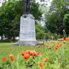 Cairn in Town Park, Gananoque, Ontario during poppy season 2017.